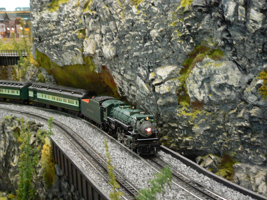 Gsmr Train And Rock Cliffs A Train Passes Through A