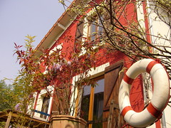 red house with lifebuoy | by Maurelita