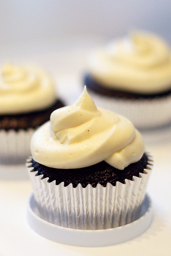 dark chocolate cupcakes with whipped white chocolate ganache | by angiemckaig