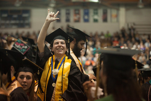 "A student flashes the sign for ""I love you"" at Gallaudet University's 2016 graduation ceremony"