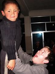 Lifting up Tibetan kids - a local pasttime..