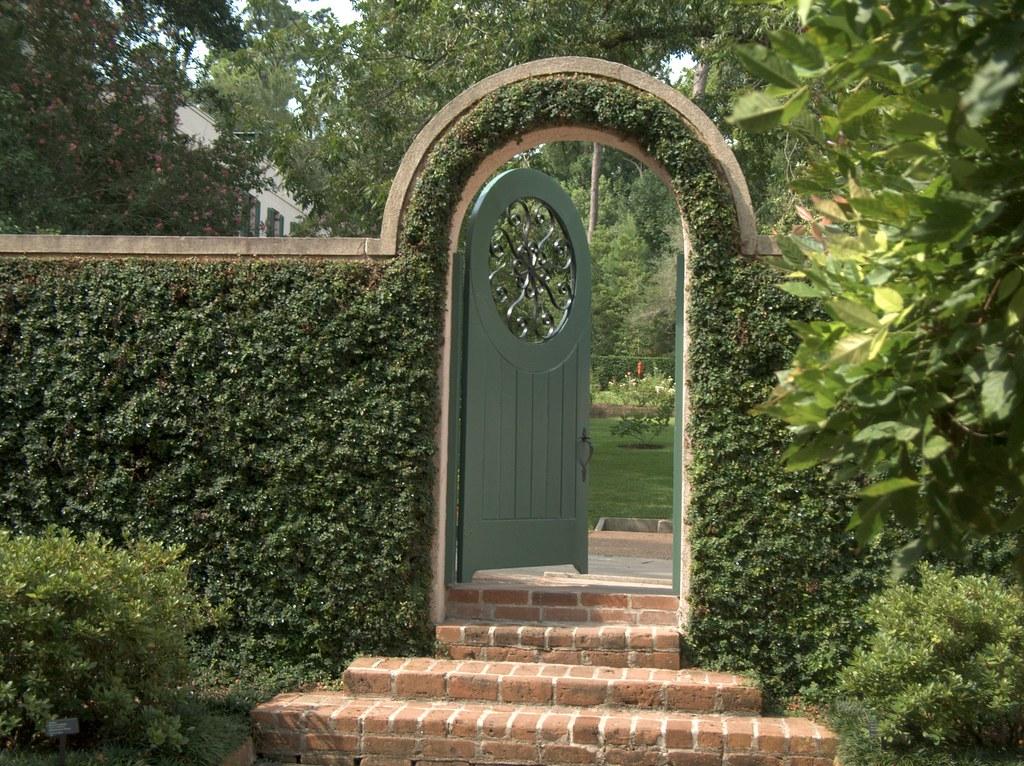 The open gate entryway to bayou bend mario flickr - When you walk through the garden ...