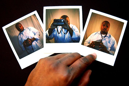 ashy hands rest on pictures of spectra happy dude (a self portrait) | by jon madison