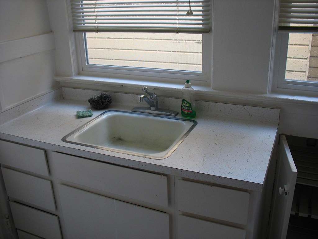 White Kitchen Sink With Black Faucet