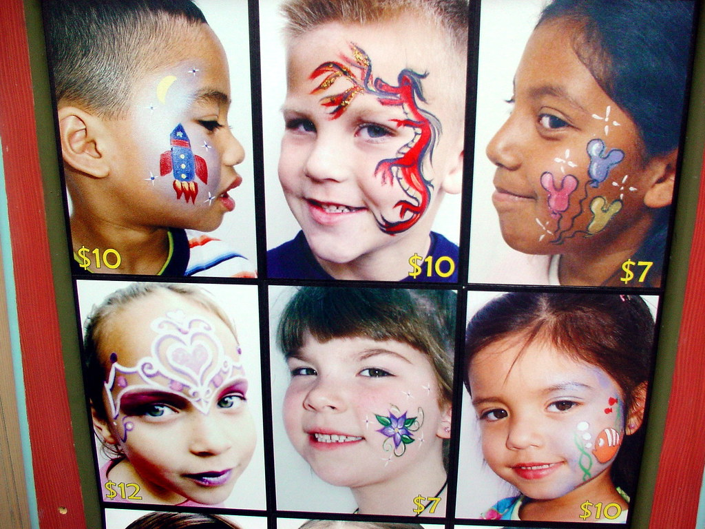 face painting examples on display at a disneyland face pai flickr