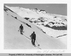 Two skiers on Old Desolate with the Carbon Glacier in background | by UW Digital Collections