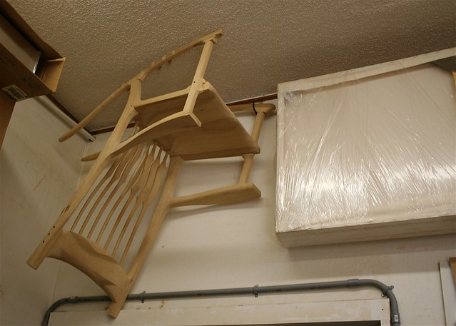 Rocking chair prototype hanging from ceiling