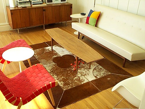living room with cowhide rug expired item saved for refer