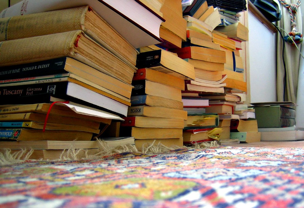 mouse-eye view | My books, piled up to be packed, on the ...