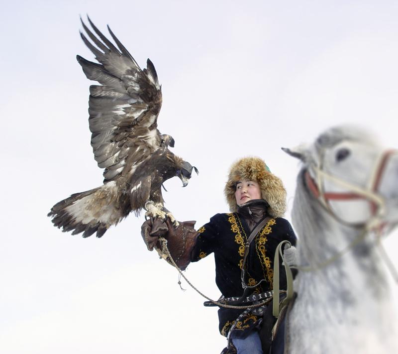 Kazakh falconer with golden eagle