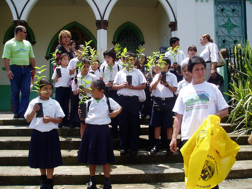 150 - maritza leading group of kids to plant trees and pick up trash | by papermakesplanes