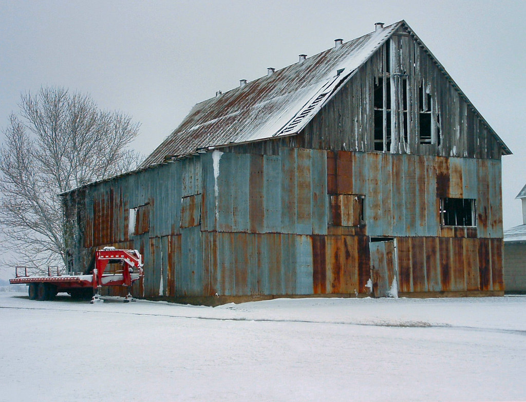 Old Barn In The Snow A Colorful Old Barn Except For The
