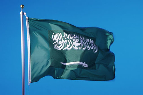 Green flag with arabic writing and swords