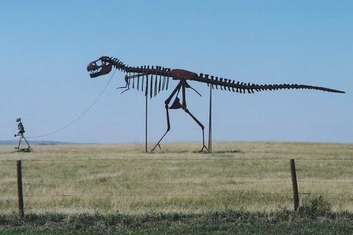 Caveman Skeleton Walks a T-Rex Skeleton | by Neato Coolville