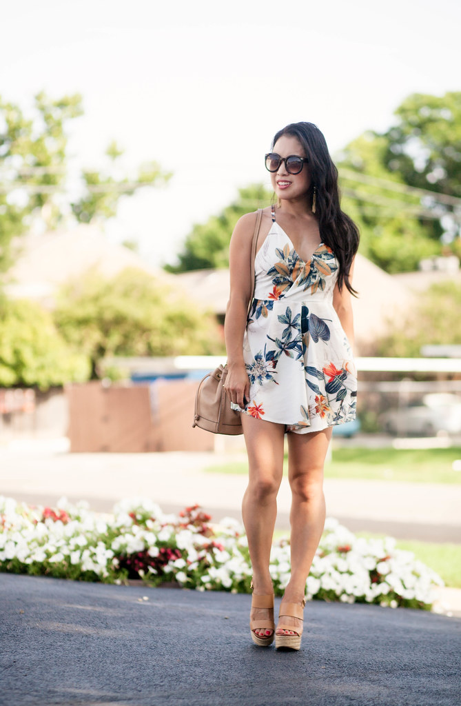 cute & little blog | petite fashion | floral criss cross strappy romper, nude espadrilles, bucket bag, tassel earrings | summer outfit