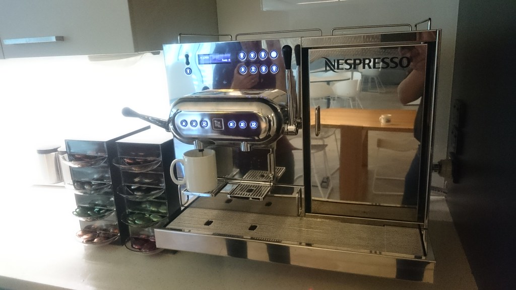 new nespresso aguila 220 coffee machine on the meeting roo. Black Bedroom Furniture Sets. Home Design Ideas