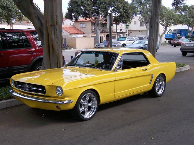 Yellow mustang under the hood this mustang is quite for Garage ford orange