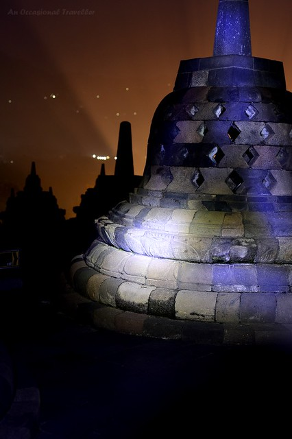 Using our flashlights to light up the stupas