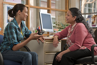 A peer counselor with a mother | by USDAgov