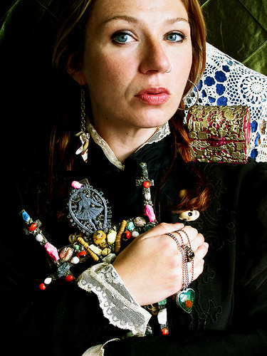 self-portrait with cuandera cross, skulls and milagro box | by Heather Corinna