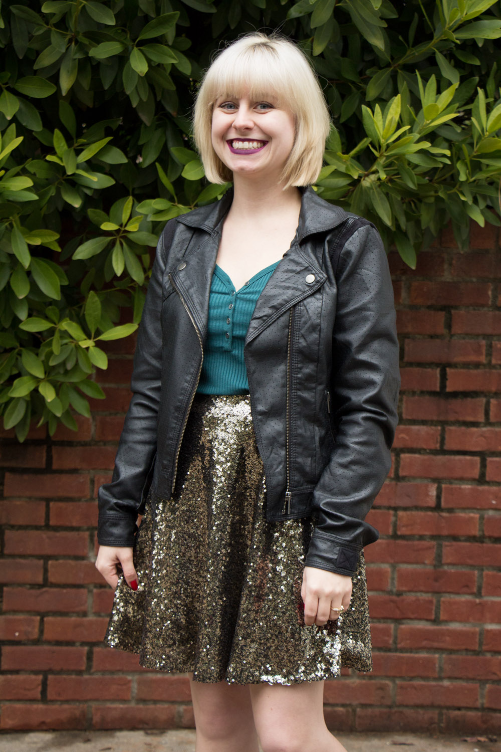 Blonde Hair with Bangs Faux Leather Jacket Sparkly Skater Skirt