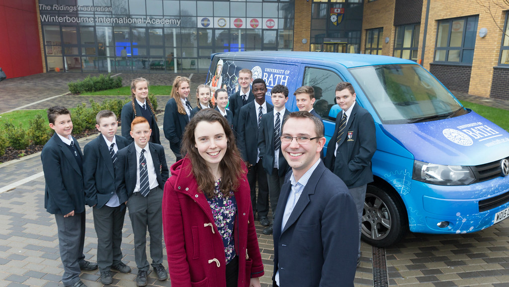 Andrew Ross and Rachael Baker outside a local school with the STEM outreach van and some school students