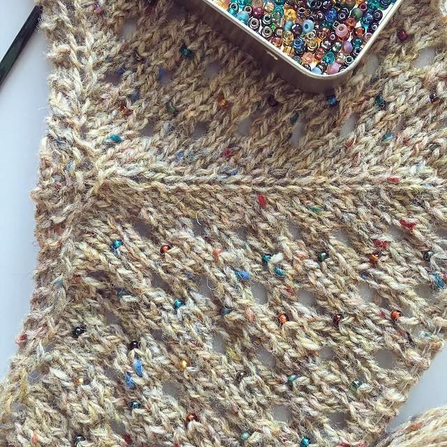 Tweed wool and beads makes this shawl look like funfetti. 🎉 #knitting #shawlknitting #beadknitting #funfetti