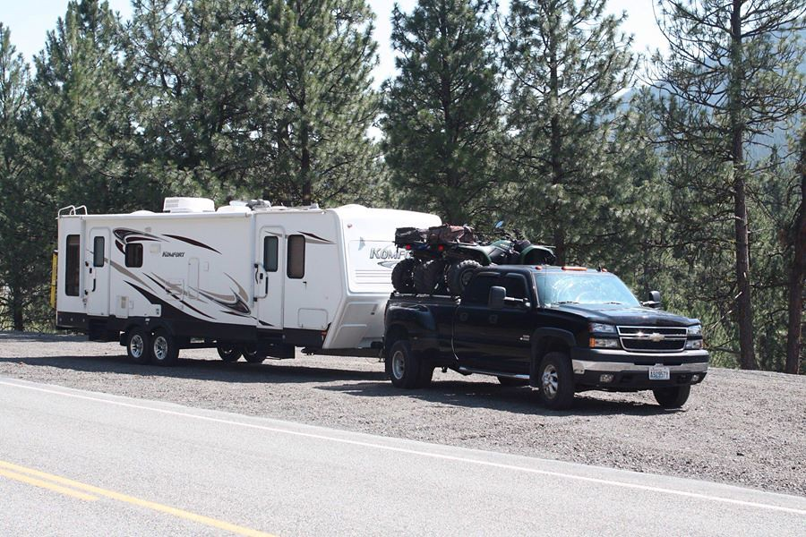 A Chevy Silverado With An ATV Carrier Pulls A Camper Trail… | Flickr
