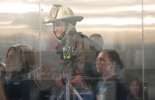A firefighter is pictured in a heated chamber.