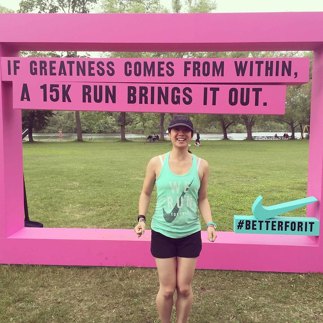 "Mei and a Nike sign that says ""If greatness comes from within, a 15k run brings it out."""