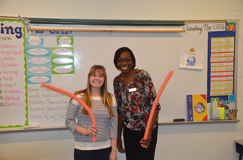 Pick Elementary teacher LaNedra Dear and Auburn University student intern Chelsea Stone holding wind tubes.