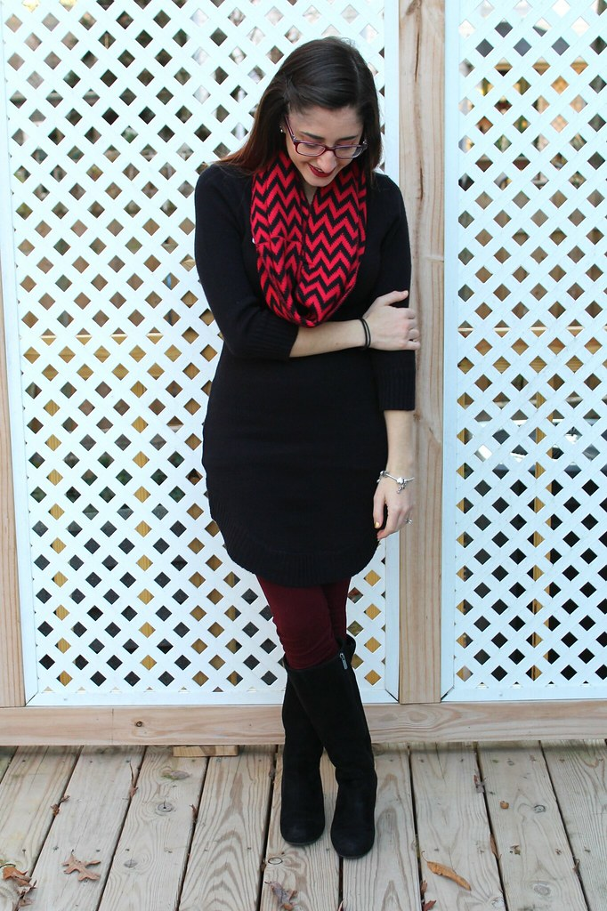 Black sweater dress, red and black chevron scarf, maroon tights