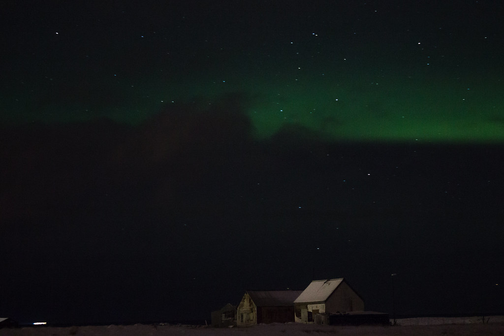 The northern lights over a farmhouse in Iceland