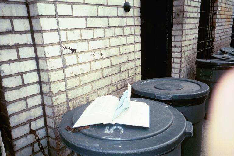 NYC: Book on a garbage can