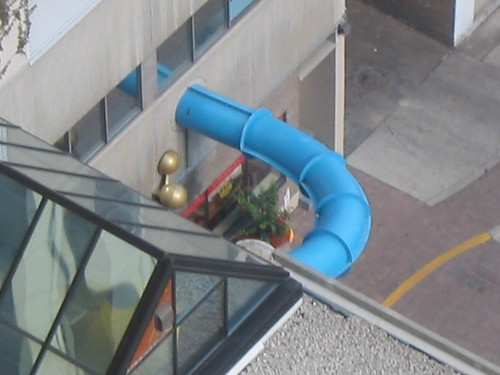 Corkscrew water slide that pops out of the building at one point | by mutantlog