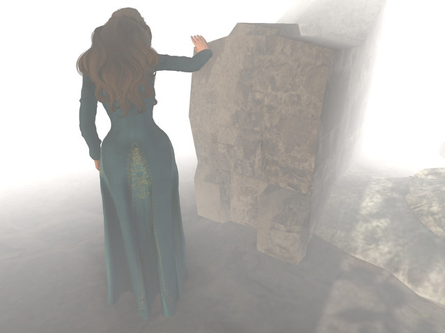 Haunting her ruined home