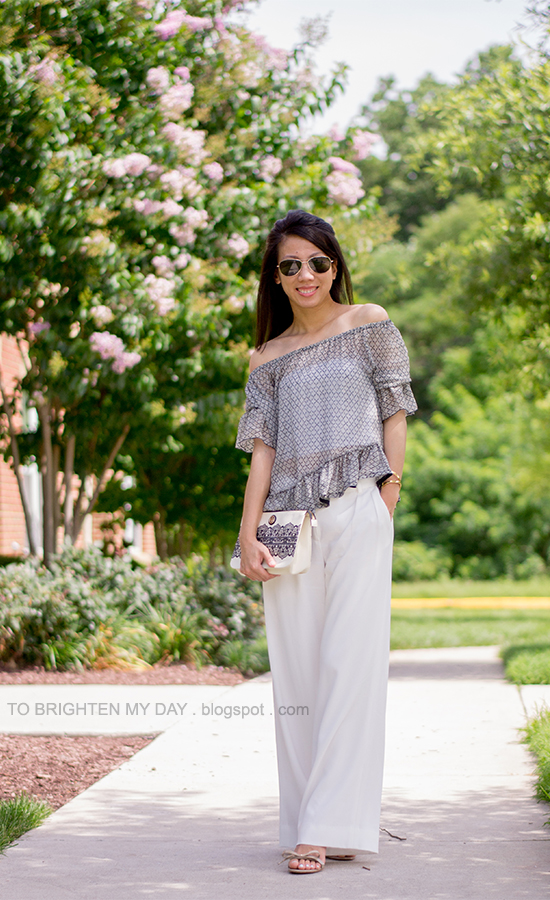 sheer off-the-shoulder ruffle top, white pants, nude sandals, lace printed clutch