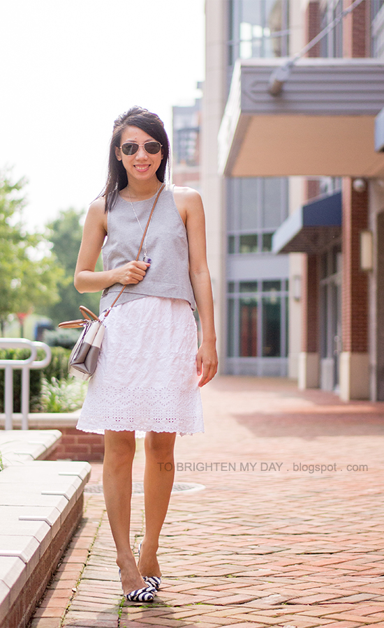 gray cropped vest, white eyelet dress, colorblocked crossbody bag, striped flats