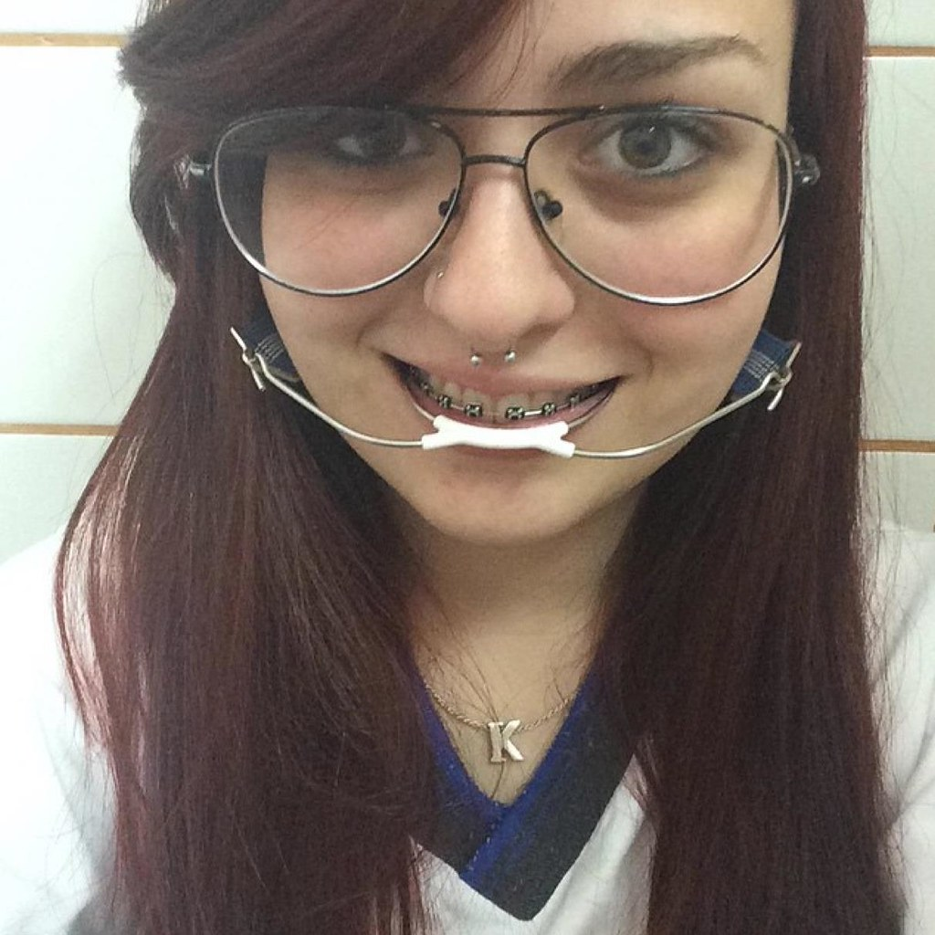 Orthodontic Headgear and nose ring | Woman wearing ... Cervical Piercing