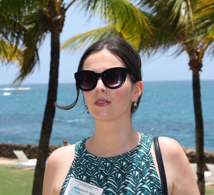 professional outfit: fitted palm leaf print dress, cat eye sunglasses
