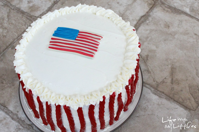Celebrate the Fourth of July with this easy and delicious patriotic layer cake! It's way easier than it looks, and uses Twizzlers for the decorations!
