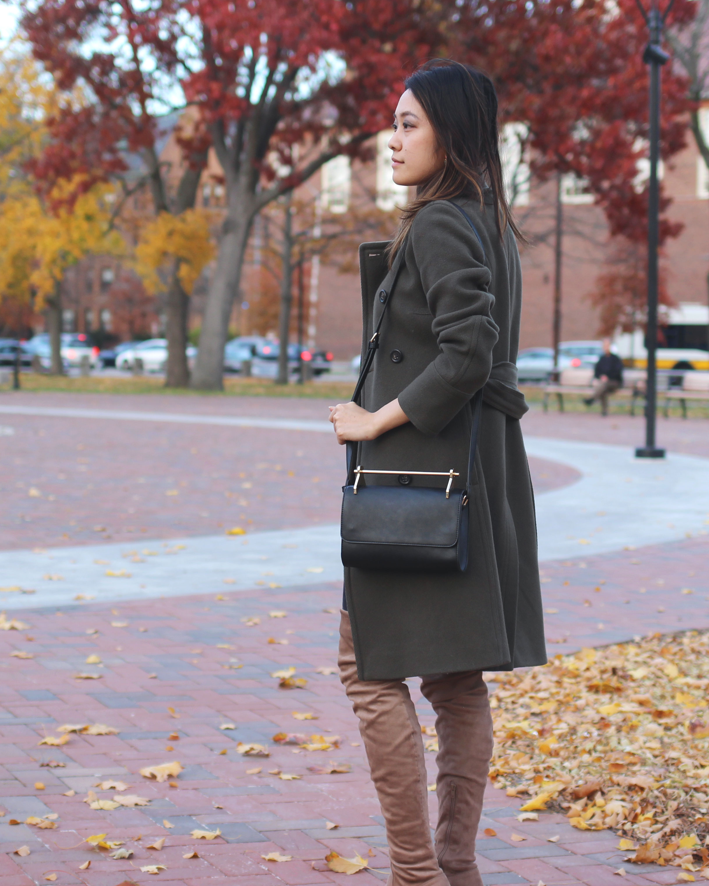 Gold handle black bag and taupe over the knee boots