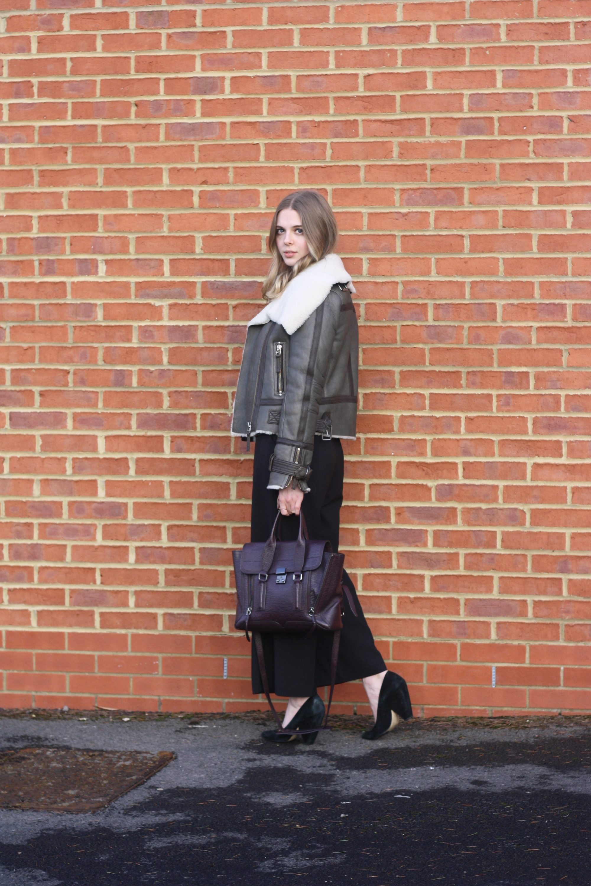 Topshop sheepskin jacket, Zara black wide legged trousers and Whistles black suede courts