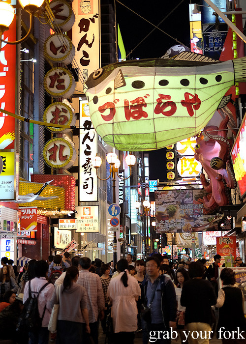 Giant puffer fish above the crowds on Dotonbori, Osaka, Japan