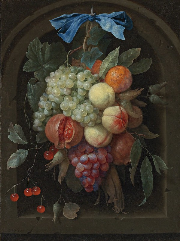 Joris van Son - Still life of grapes, peaches, a pomegranate and other fruit hanging from a nail before a stone niche