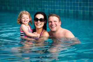 Family fun in the pool | by Aaron Miller - Postcard Intellect