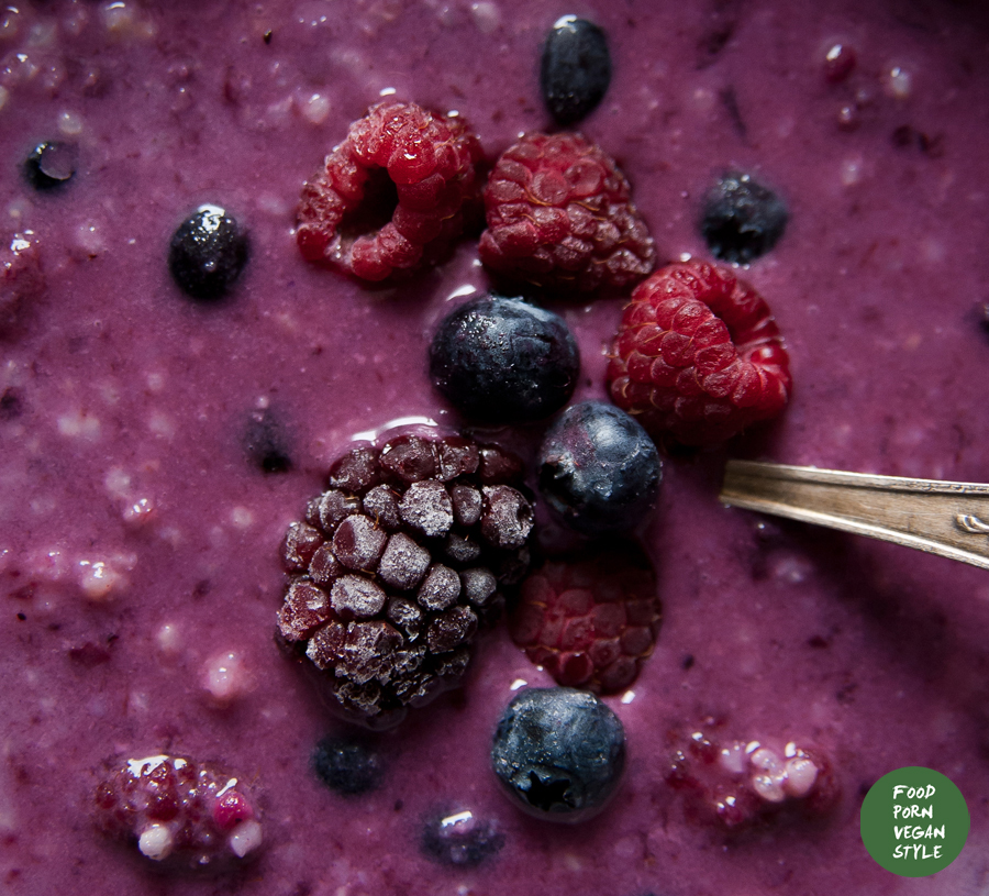 Millet porridge with a homemade blueberry jam, frozen fruits and hazelnut milk