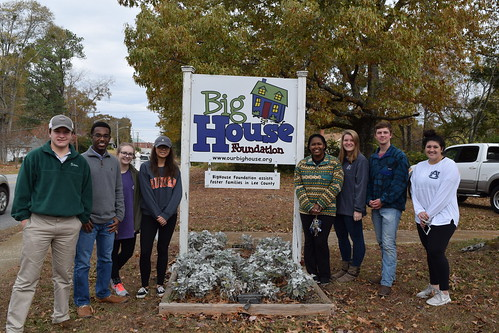 Harbert College's Freshman Focus students pose in front of the BigHouse sign.