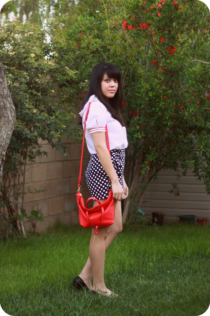 "Sweets and Hearts style outfit: White and red cotton vintage sailor blouse (from Wasteland) High-waisted polka-dot sailor shorts ( Voodoo Vixen) Red leather satchel (Kate Spade Saturday) Vintage-style pocketwatch ""Turn Back Time"" necklace (ModCloth) Black leather bow stud ballet flats (Circus by Sam Edelman)"
