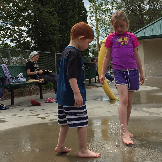 Splash park with two kids and a teen.